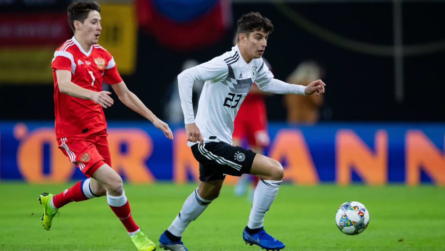 LEIPZIG, GERMANY - NOVEMBER 15: Kai Havertz of Germany is challenged by Daler Kuzyaev of Russia during the International Friendly match between Germany and Russia at Red Bull Arena on November 15, 2018 in Leipzig, Germany. (Photo by Simon Hofmann/Getty Images)