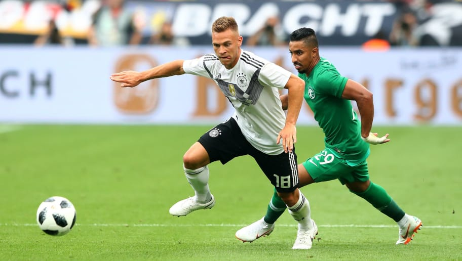 LEVERKUSEN, GERMANY - JUNE 08: Joshua Kimmich (L) of Germany and Salem Al Dawsari of Saudi Arabia battle for the ball during the International Friendly match between Germany and Saudi Arabia at BayArena on June 8, 2018 in Leverkusen, Germany.  (Photo by Martin Rose/Bongarts/Getty Images)