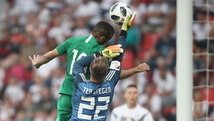 LEVERKUSEN, GERMANY - JUNE 08: Goalkeeper Marc-Andre ter Stegen of Germany makes a save against Fahad-Al-Muwallad of Saudi Arabia during the international friendly match between Germany and Saudi Arabia ahead of the FIFA World Cup Russia 2018 at BayArena on June 8, 2018 in Leverkusen, Germany.  (Photo by Alex Grimm/Bongarts/Getty Images)