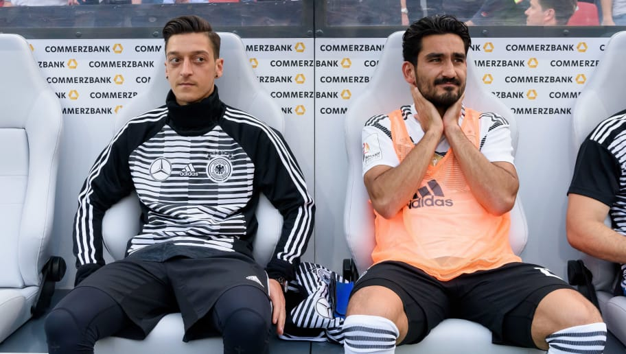 LEVERKUSEN, GERMANY - JUNE 08: Mesut Oezil of Germany and Ilkay Guendogan of Germany sit on the bench prior to the international friendly match between Germany and Saudi Arabia at BayArena on June 8, 2018 in Leverkusen, Germany. (Photo by TF-Images/Getty Images)