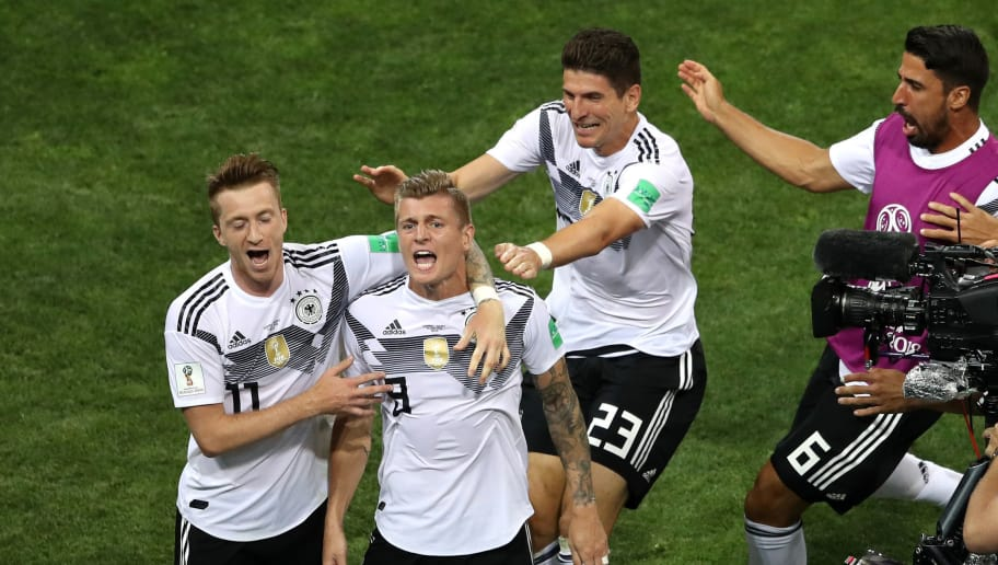 SOCHI, RUSSIA - JUNE 23:  Toni Kroos of Germany celebrates with teammates Marco Reus (l) and Mario Gomez after scoring his sides winning goal during the 2018 FIFA World Cup Russia group F match between Germany and Sweden at Fisht Stadium on June 23, 2018 in Sochi, Russia.  (Photo by Michael Steele/Getty Images)