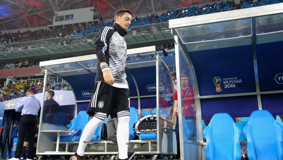 SOCHI, RUSSIA - JUNE 23:  Mesut Oezil of Germany walks on the pitch prior to the 2018 FIFA World Cup Russia group F match between Germany and Sweden at Fisht Stadium on June 23, 2018 in Sochi, Russia.  (Photo by Alexander Hassenstein/Getty Images)