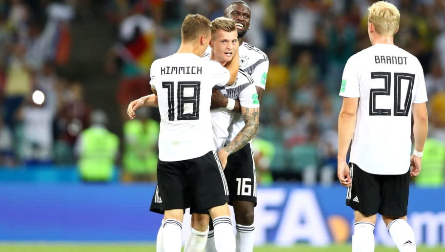 SOCHI, RUSSIA - JUNE 23:  Toni Kroos of Germany is congratualted at final whistle by Joshua Kimmich and Antonio Ruediger following the 2018 FIFA World Cup Russia group F match between Germany and Sweden at Fisht Stadium on June 23, 2018 in Sochi, Russia.  (Photo by Dean Mouhtaropoulos/Getty Images)