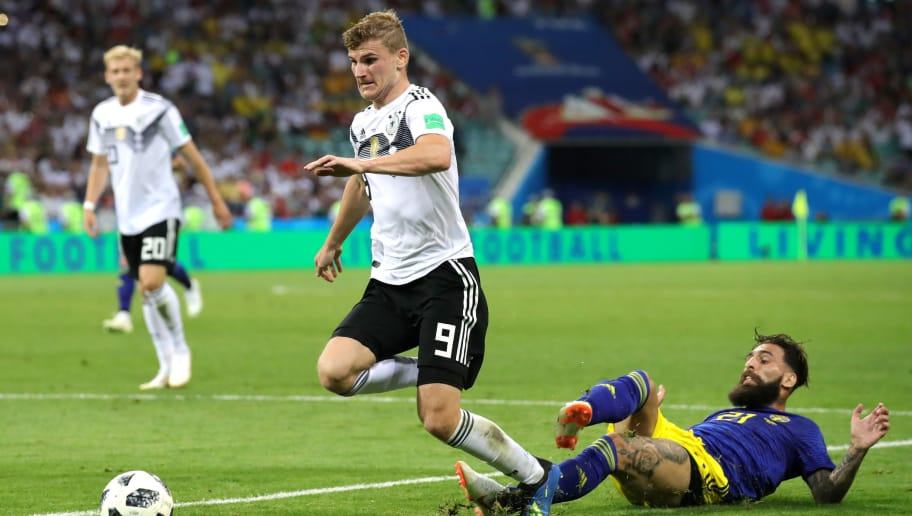 SOCHI, RUSSIA - JUNE 23:  Timo Werner of Germany gets fouled by Jimmmy Durmaz of Sweden ahead of Germany's second goal during the 2018 FIFA World Cup Russia group F match between Germany and Sweden at Fisht Stadium on June 23, 2018 in Sochi, Russia.  (Photo by Alexander Hassenstein/Getty Images)
