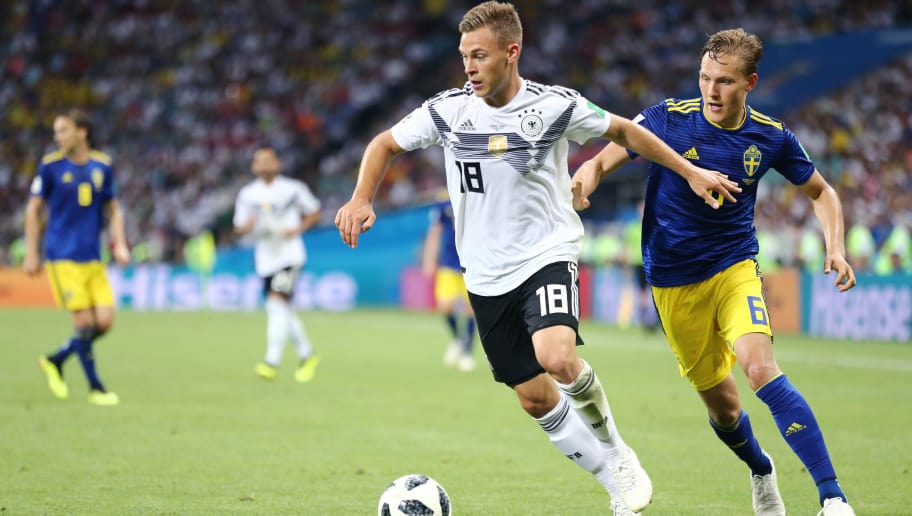 SOCHI, RUSSIA - June 23: Ludwig Augustinsson #6 of Sweden defends Joshua Kimmich #18 of Germany during the 2018 FIFA World Cup Russia group F match between Germany and Sweden at Fisht Stadium on June 23, 2018 in Sochi, Russia. (Photo by Maddie Meyer/Getty Images)