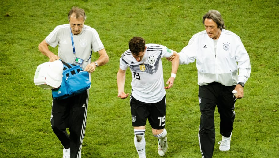 SOCHI, RUSSIA - JUNE 23: Sebastian Rudy of Germany is being escorted to the sideline after suffering an injury during the 2018 FIFA World Cup Russia group F match between Germany and Sweden at Fisht Stadium on June 23, 2018 in Sochi, Russia. (Photo by Reinaldo Coddou H./Getty Images)