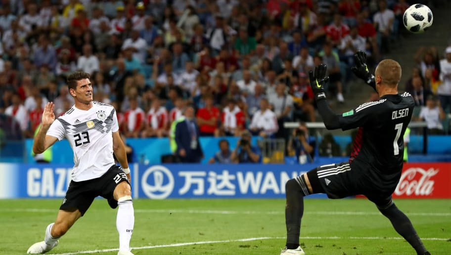 SOCHI, RUSSIA - JUNE 23:  Mario Gomez of Germany misses a chance on goal as he shoots over as Robin Olsen of Sweden closes him down during the 2018 FIFA World Cup Russia group F match between Germany and Sweden at Fisht Stadium on June 23, 2018 in Sochi, Russia.  (Photo by Dean Mouhtaropoulos/Getty Images)
