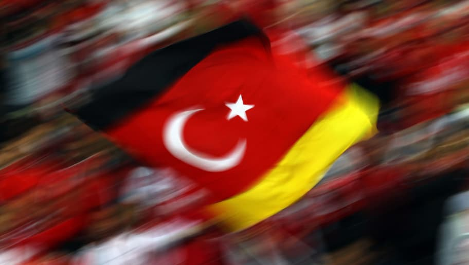 BERLIN - OCTOBER 08: Fans of Turkey wave a flag during the EURO 2012 Group A qualifier match between Germany and Turkey at Olympic Stadium on October 8, 2010 in Berlin, Germany.  (Photo by Lars Baron/Bongarts/Getty Images)