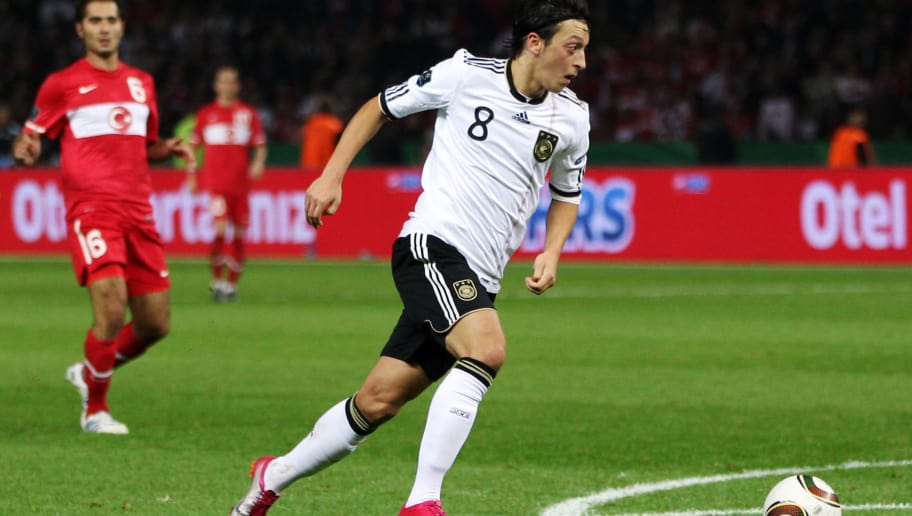 BERLIN - OCTOBER 08: Mesut Oezil of Germany scores his team's second goal during the EURO 2012 group A qualifier match between Germany and Turkey at the Olympic Stadium on October 8, 2010 in Berlin, Germany.  (Photo by Alex Grimm/Bongarts/Getty Images)