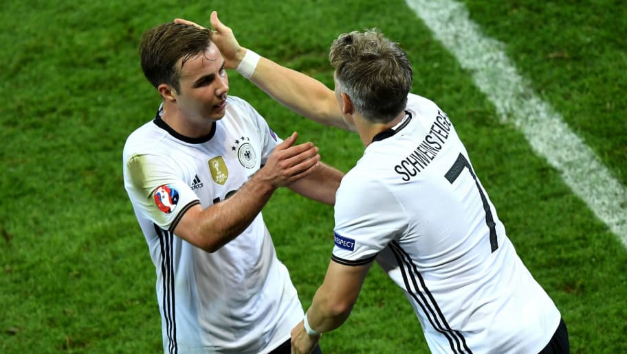 LILLE, FRANCE - JUNE 12:  Bastian Schweinsteiger (R) of Germany relaces Mario Goetze (L) during the UEFA EURO 2016 Group C match between Germany and Ukraine at Stade Pierre-Mauroy on June 12, 2016 in Lille, France.  (Photo by Shaun Botterill/Getty Images)