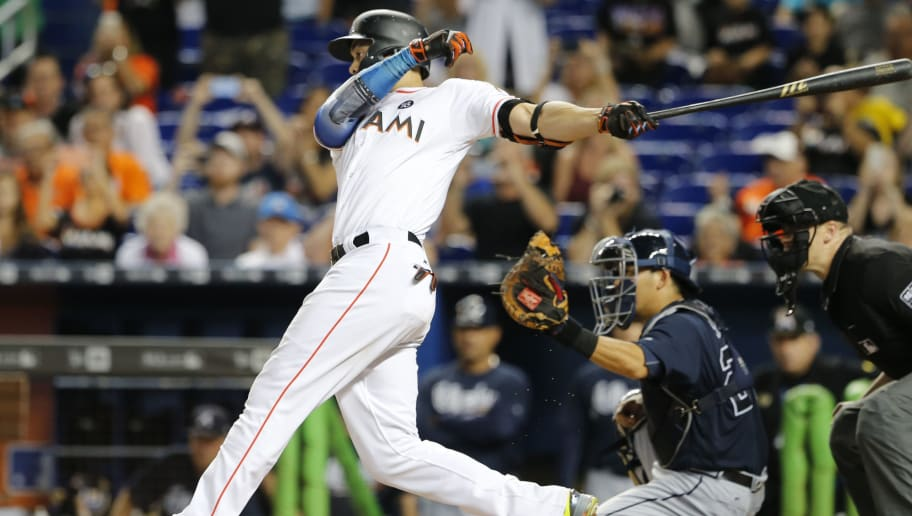 MIAMI, FL - OCTOBER 1:  Giancarlo Stanton #27 of the Miami Marlins strikes out in the ninth inning in front of Kurt Suzuki #24 of the Atlanta Braves, ending his bid for 60 home runs for the season at Marlins Park on October 1, 2017 in Miami, Florida.  (Photo by Joe Skipper/Getty Images)