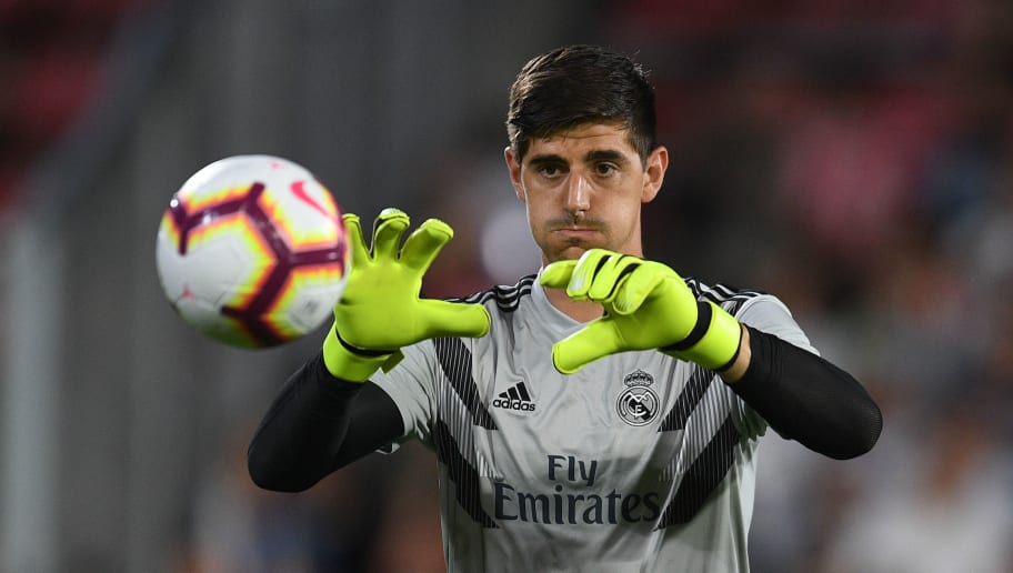 GIRONA, SPAIN - AUGUST 26:  Thibaut Courtois of Real Madrid CF in action during the warm up prior to the La Liga match between Girona FC and Real Madrid CF at Montilivi Stadium on August 26, 2018 in Girona, Spain.  (Photo by David Ramos/Getty Images)