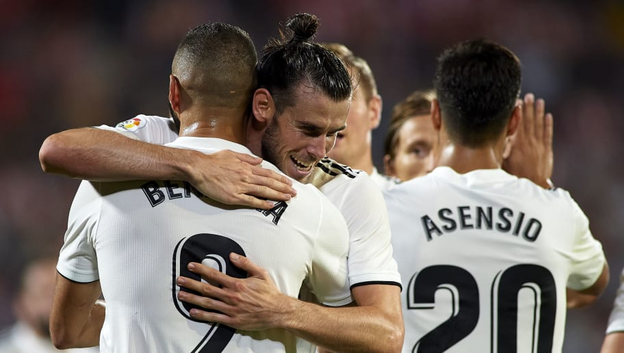 GIRONA, SPAIN - AUGUST 26:  Karim Benzema of Real Madrid celebrates after scoring his sides second goal with his teammate Gareth Bale during the La Liga match between Girona FC and Real Madrid CF at Montilivi Stadium on August 26, 2018 in Girona, Spain.  (Photo by Quality Sport Images/Getty Images)
