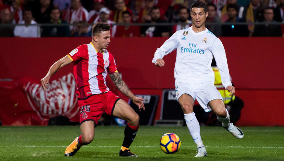 GIRONA, SPAIN - OCTOBER 29:  Cristiano Ronaldo of Real Madrid CF fights for the ball with Pablo Maffeo of Girona FC during the La Liga match between Girona and Real Madrid at Estadi de Montilivi on October 29, 2017 in Girona, Spain.  (Photo by Alex Caparros/Getty Images)