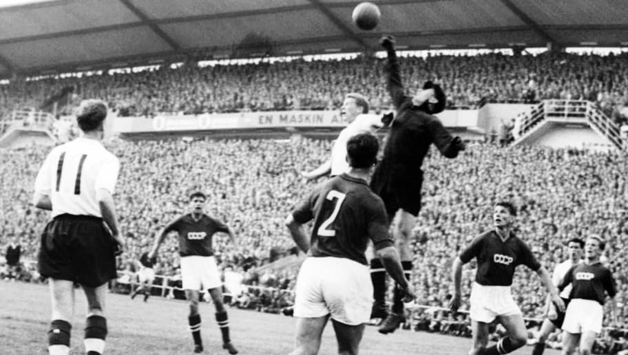 Goalkeeper Lev Yashin (black) from the Soviet Union boxes the ball away from an English player during the World Cup first round soccer match between the Soviet Union and England 08 June 1958 in Goteborg. The match ended in a 2-2 tie. AFP PHOTO/PRESSENBILD (Photo credit should read STAFF/AFP/Getty Images)