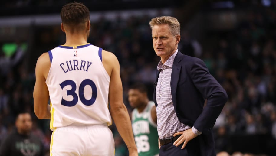 BOSTON, MA - NOVEMBER 16: Steve Kerr of the Golden State Warriors talks with Stephen Curry #30 during the first quarter against the Boston Celtics at TD Garden on November 16, 2017 in Boston, Massachusetts.  (Photo by Maddie Meyer/Getty Images)