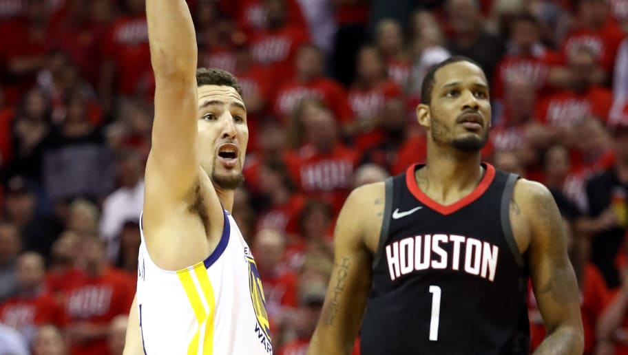 HOUSTON, TX - MAY 14: Klay Thompson #11 of the Golden State Warriors reacts after a shot in the second half against Trevor Ariza #1 of the Houston Rockets in Game One of the Western Conference Finals of the 2018 NBA Playoffs at Toyota Center on May 14, 2018 in Houston, Texas. NOTE TO USER: User expressly acknowledges and agrees that, by downloading and or using this photograph, User is consenting to the terms and conditions of the Getty Images License Agreement.  (Photo by Ronald Martinez/Getty Images)