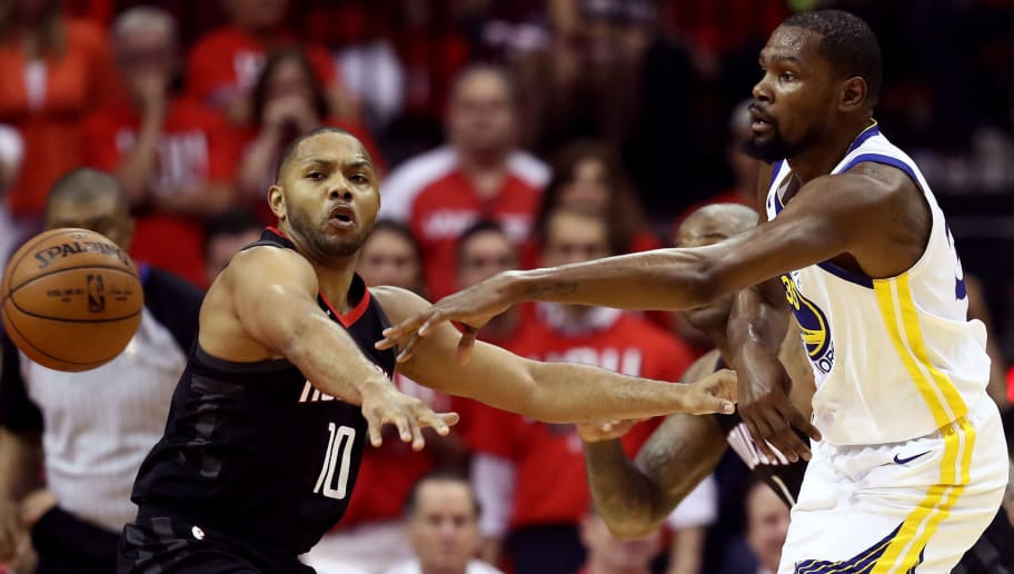 HOUSTON, TX - MAY 14: Kevin Durant #35 of the Golden State Warriors passes against Eric Gordon #10 of the Houston Rockets in the first half in Game One of the Western Conference Finals of the 2018 NBA Playoffs at Toyota Center on May 14, 2018 in Houston, Texas. NOTE TO USER: User expressly acknowledges and agrees that, by downloading and or using this photograph, User is consenting to the terms and conditions of the Getty Images License Agreement.  (Photo by Ronald Martinez/Getty Images)
