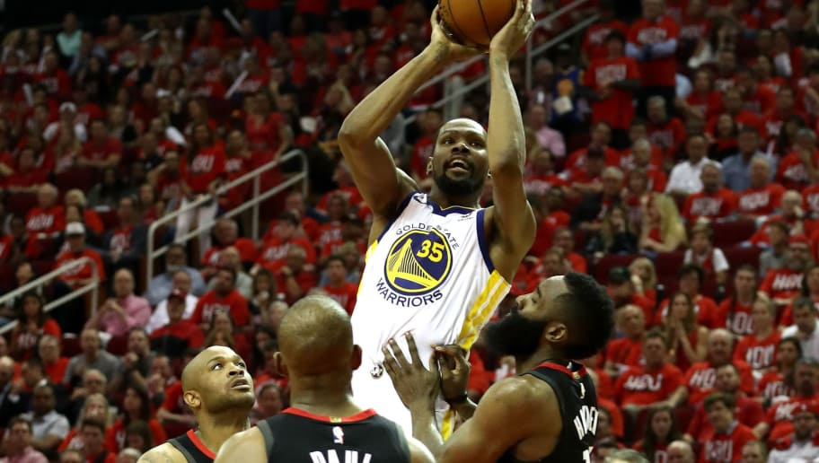 HOUSTON, TX - MAY 14:  Kevin Durant #35 of the Golden State Warriors shoots against James Harden #13 of the Houston Rockets in the second half in Game One of the Western Conference Finals of the 2018 NBA Playoffs at Toyota Center on May 14, 2018 in Houston, Texas. NOTE TO USER: User expressly acknowledges and agrees that, by downloading and or using this photograph, User is consenting to the terms and conditions of the Getty Images License Agreement.  (Photo by Ronald Martinez/Getty Images)