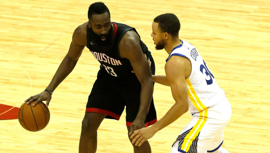 HOUSTON, TX - MAY 14: James Harden #13 of the Houston Rockets handles the ball against Stephen Curry #30 of the Golden State Warriors in the second half in Game One of the Western Conference Finals of the 2018 NBA Playoffs at Toyota Center on May 14, 2018 in Houston, Texas. NOTE TO USER: User expressly acknowledges and agrees that, by downloading and or using this photograph, User is consenting to the terms and conditions of the Getty Images License Agreement.  (Photo by Bob Levey/Getty Images)