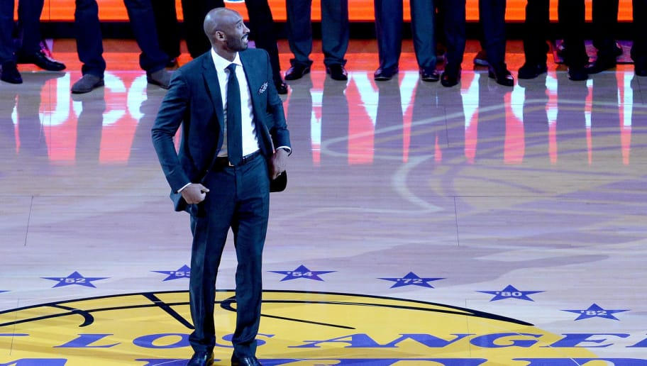 LOS ANGELES, CA - DECEMBER 18:  Kobe Bryant looks up at the rafters at halftime as both his #8 and #24 Los Angeles Lakers jerseys are retired at Staples Center on December 18, 2017 in Los Angeles, California. NOTE TO USER: User expressly acknowledges and agrees that, by downloading and or using this photograph, User is consenting to the terms and conditions of the Getty Images License Agreement.  (Photo by Maxx Wolfson/Getty Images)