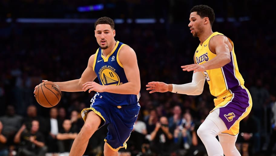 LOS ANGELES, CA - DECEMBER 18:  Klay Thompson #11 of the Golden State Warriors drives on Josh Hart #5 of the Los Angeles Lakers in the first half at Staples Center on December 18, 2017 in Los Angeles, California. NOTE TO USER: User expressly acknowledges and agrees that, by downloading and or using this photograph, User is consenting to the terms and conditions of the Getty Images License Agreement.  (Photo by Harry How/Getty Images)