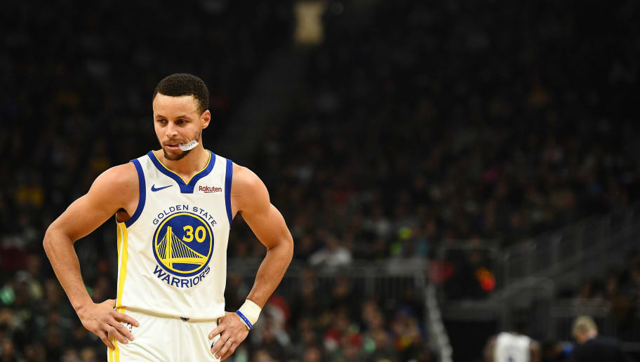 MILWAUKEE, WISCONSIN - DECEMBER 07: Stephen Curry #30 of the Golden State Warriors waits for a free throw during a game against the Milwaukee Buck at Fiserv Forum on December 07, 2018 in Milwaukee, Wisconsin. The Warriors defeated the Bucks 105-95.  NOTE TO USER: User expressly acknowledges and agrees that, by downloading and or using this photograph, User is consenting to the terms and conditions of the Getty Images License Agreement.   (Photo by Stacy Revere/Getty Images)