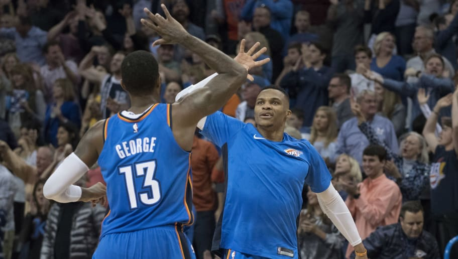 OKLAHOMA CITY, OK - NOVEMBER 22: Paul George #13 of the Oklahoma City Thunder and Russell Westbrook #0 of the Oklahoma City Thunder celebrate during the second half of a NBA  game against the Golden State Warriors  at the Chesapeake Energy Arena on November 22, 2017 in Oklahoma City, Oklahoma. NOTE TO USER: User expressly acknowledges and agrees that, by downloading and or using this photograph, User is consenting to the terms and conditions of the Getty Images License Agreement. (Photo by J Pat Carter/Getty Images)