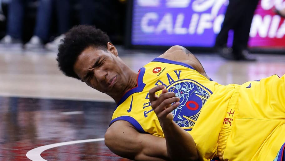 SACRAMENTO, CA - MARCH 31: Patrick McCaw #0 of the Golden State Warriors lands heavily after being fouled by Vince Carter #15 of the Sacramento Kings at Golden 1 Center on March 31, 2018 in Sacramento, California. McCaw was stretchered from the court after the incident. NOTE TO USER: User expressly acknowledges and agrees that, by downloading and or using this photograph, User is consenting to the terms and conditions of the Getty Images License Agreement. (Photo by Lachlan Cunningham/Getty Images)