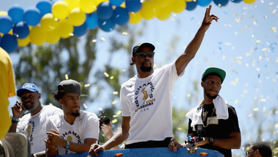 OAKLAND, CA - JUNE 12:  Kevin Durant #35 of the Golden State Warriors gestures to the crowd during the Golden State Warriors Victory Parade on June 12, 2018 in Oakland, California.  The Golden State Warriors beat the Cleveland Cavaliers 4-0 to win the 2018 NBA Finals. NOTE TO USER: User expressly acknowledges and agrees that, by downloading and or using this photograph, User is consenting to the terms and conditions of the Getty Images License Agreement.  (Photo by Ezra Shaw/Getty Images)