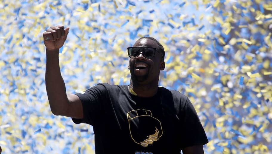OAKLAND, CA - JUNE 12:  Draymond Green of the Golden State Warriors is covered with confetti as he celebrates during the Golden State Warriors Victory Parade on June 12, 2018 in Oakland, California. The Golden State Warriors beat the Cleveland Cavaliers 4-0 to win the 2018 NBA Finals. NOTE TO USER: User expressly acknowledges and agrees that, by downloading and/or using this photograph, user is consenting to the terms and conditions of the Getty Images License Agreement.  (Photo by Justin Sullivan/Getty Images)