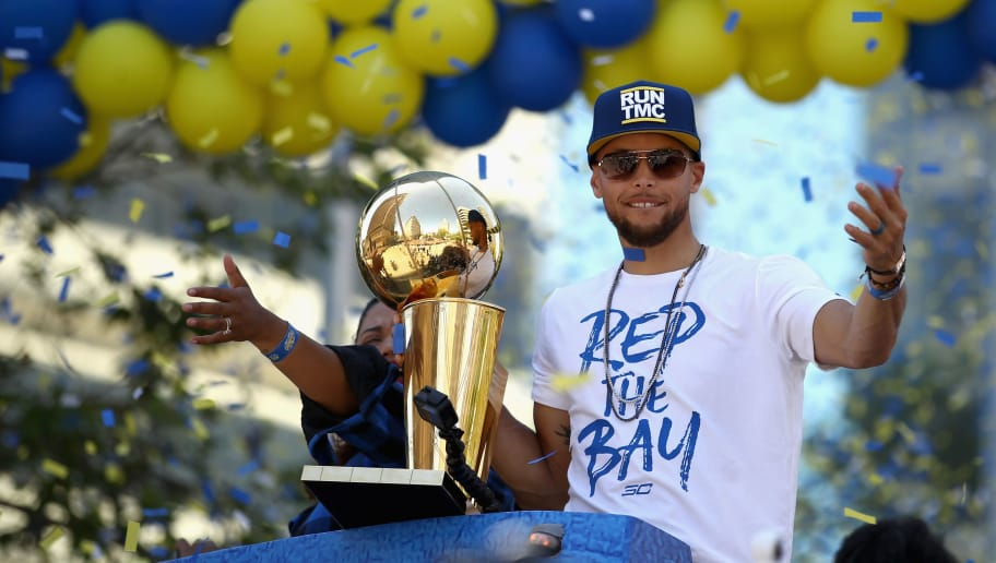 OAKLAND, CA - JUNE 12:  Stephen Curry #30 of the Golden State Warriors hold the championship trophy during the Golden State Warriors Victory Parade on June 12, 2018 in Oakland, California.  The Golden State Warriors beat the Cleveland Cavaliers 4-0 to win the 2018 NBA Finals. NOTE TO USER: User expressly acknowledges and agrees that, by downloading and or using this photograph, User is consenting to the terms and conditions of the Getty Images License Agreement.  (Photo by Ezra Shaw/Getty Images)
