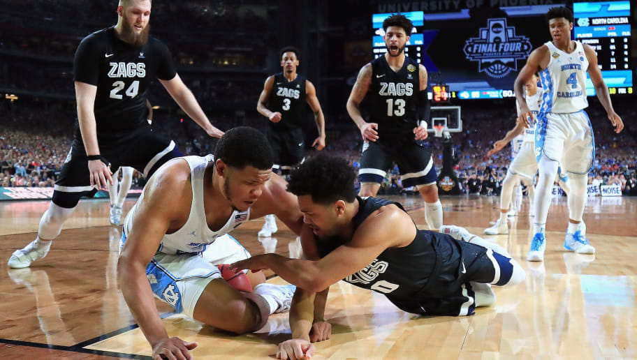 GLENDALE, AZ - APRIL 03:  Kennedy Meeks #3 of the North Carolina Tar Heels and Silas Melson #0 of the Gonzaga Bulldogs compete for the ball in the second half during the 2017 NCAA Men's Final Four National Championship game at University of Phoenix Stadium on April 3, 2017 in Glendale, Arizona. The North Carolina Tar Heels were awarded possession after a jump ball was called.  (Photo by Tom Pennington/Getty Images)