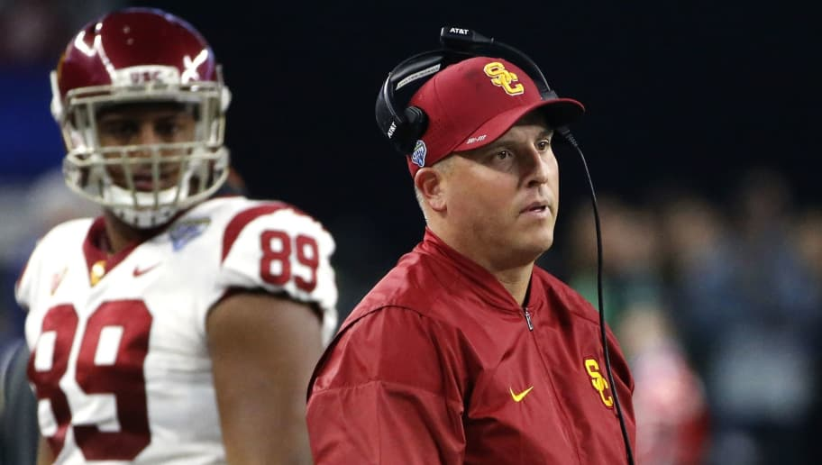ARLINGTON, TX - DECEMBER 29: Head coach Clay Helton and Austin Applebee #89 of the USC Trojans look toward the field in the first half of the 82nd Goodyear Cotton Bowl Classic between USC and Ohio State at AT&T Stadium on December 29, 2017 in Arlington, Texas. (Photo by Ron Jenkins/Getty Images)