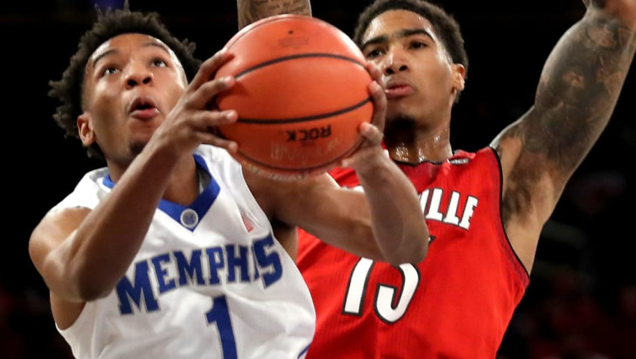 NEW YORK, NY - DECEMBER 16: Jamal Johnson #1 of the Memphis Tigers takes a shot against Ray Spalding #13 of the Louisville Cardinals in the second half during their Gotham Classic game at Madison Square Garden on December 16, 2017 in New York City.  (Photo by Abbie Parr/Getty Images)