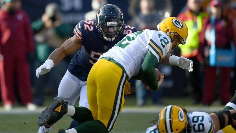 CHICAGO, IL - DECEMBER 16:  Aaron Rodgers #12 of the Green Bay Packers is sacked by Khalil Mack #52 of the Chicago Bears in the first quarter at Soldier Field on December 16, 2018 in Chicago, Illinois.  (Photo by Stacy Revere/Getty Images)
