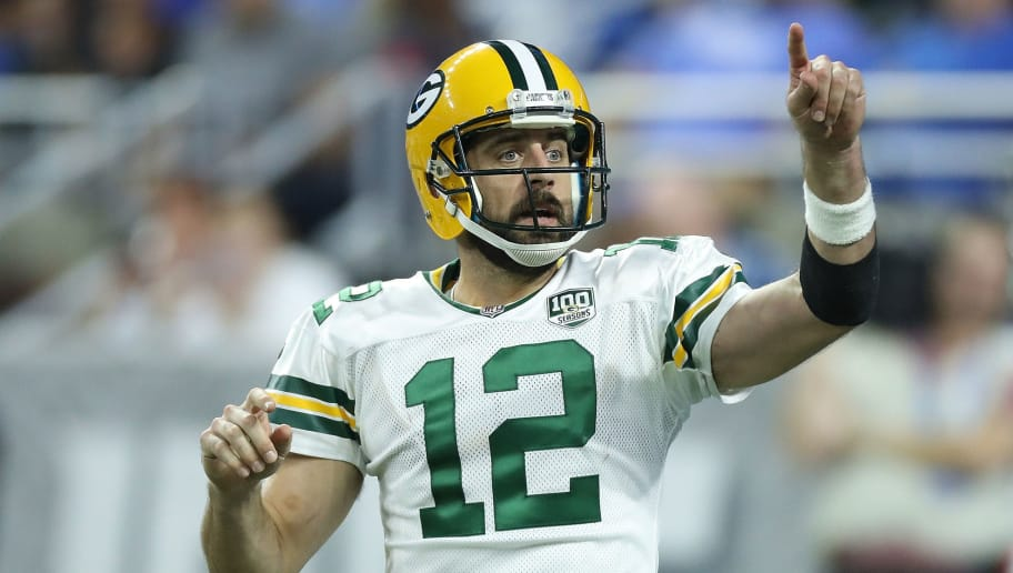 DETROIT, MI - OCTOBER 07: Aaron Rodgers #12 of the Green Bay Packers calls the play during the fourth quarter of the game against the Detroit Lions at Ford Field on October 7, 2018 in Detroit, Michigan. The Lions defeated the Packers 31-23. (Photo by Leon Halip/Getty Images) **Aaron Rodgers **
