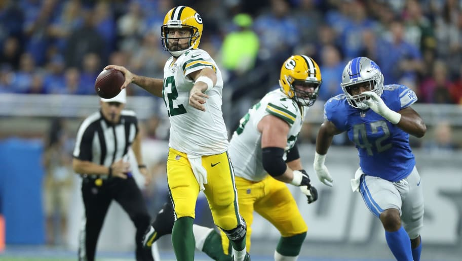 DETROIT, MI - OCTOBER 07: Aaron Rodgers #12 of the Green Bay Packers looks to pass during the first quarter of the game against the Detroit Lions at Ford Field on October 7, 2018 in Detroit, Michigan. The Lions defeated the Packers 31-23. (Photo by Leon Halip/Getty Images) ** Aaron Rodgers **