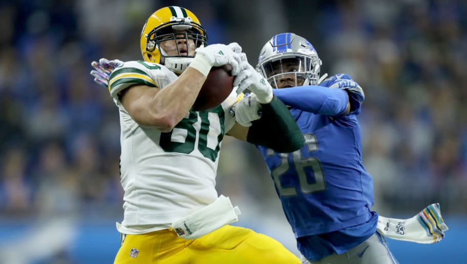 DETROIT, MI - OCTOBER 07: Jimmy Graham #80 of the Green Bay Packers makes a catch against DeShawn Shead #26 of the Detroit Lions during the first half at Ford Field on October 7, 2018 in Detroit, Michigan. (Photo by Leon Halip/Getty Images)
