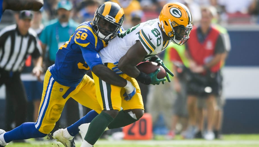 LOS ANGELES, CA - OCTOBER 28: Running back Ty Montgomery #88 of the Green Bay Packers completes a pass in the second quarter in front of linebacker Cory Littleton #58 of the Los Angeles Rams at Los Angeles Memorial Coliseum on October 28, 2018 in Los Angeles, California. (Photo by John McCoy/Getty Images)