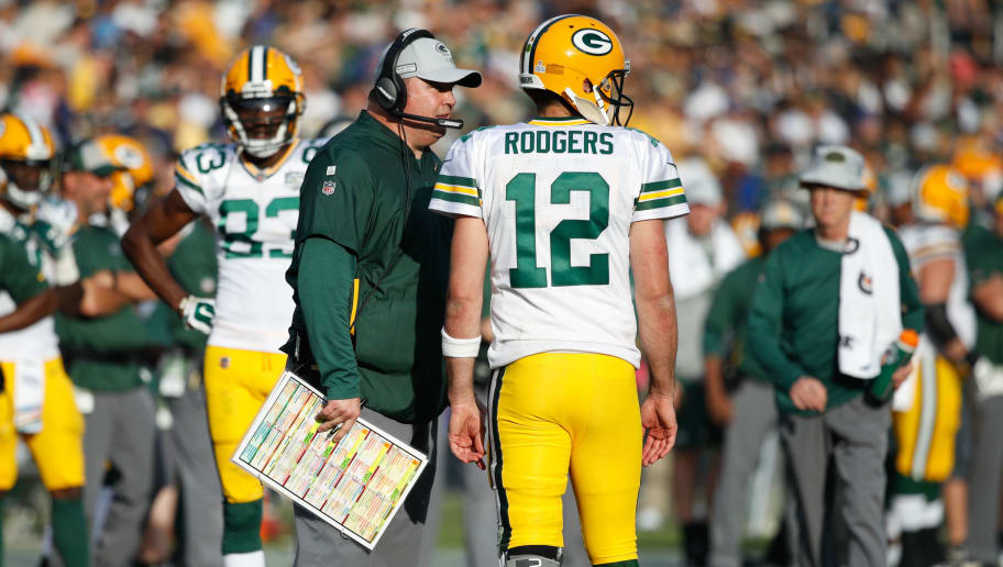 LOS ANGELES, CA - OCTOBER 28: Quarterback Aaron Rodgers #12 of the Green Bay Packers talks with head coach Mike McCarthy during the game against the Los Angeles Rams at Los Angeles Memorial Coliseum on October 28, 2018 in Los Angeles, California. (Photo by Joe Robbins/Getty Images)