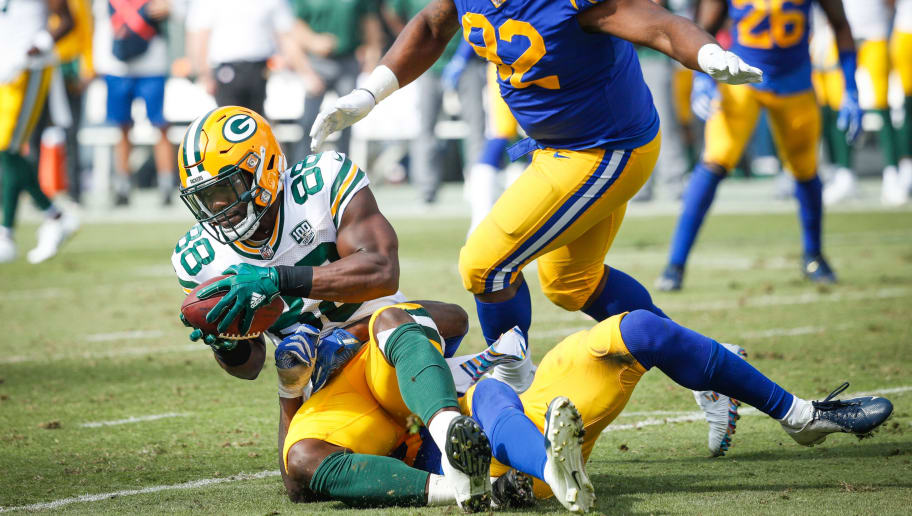 LOS ANGELES, CA - OCTOBER 28: Running back Ty Montgomery #88 of the Green Bay Packers is tackled by linebacker Cory Littleton #58 of the Los Angeles Rams at Los Angeles Memorial Coliseum on October 28, 2018 in Los Angeles, California. (Photo by Joe Robbins/Getty Images)