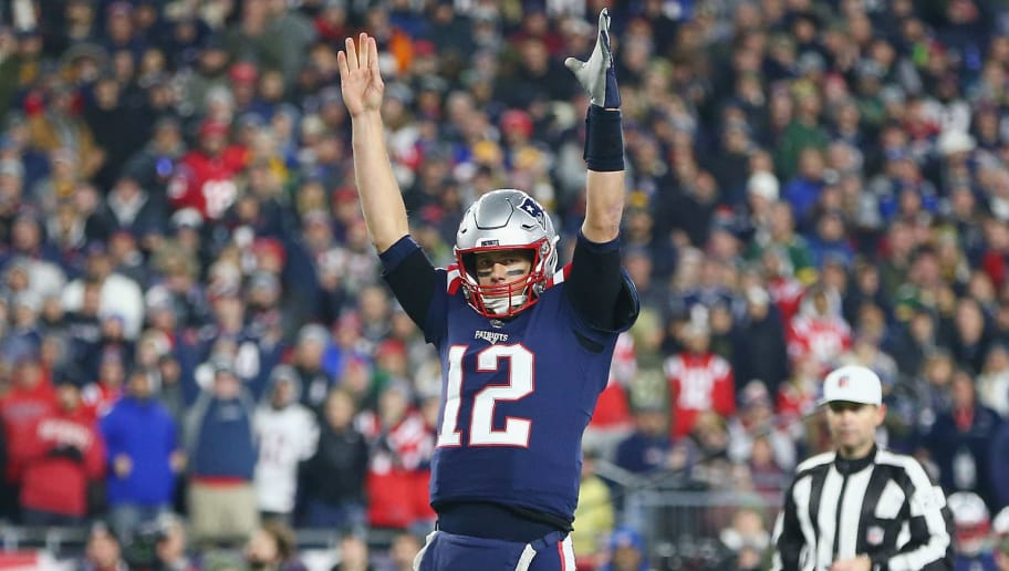FOXBOROUGH, MA - NOVEMBER 04:  Tom Brady #12 of the New England Patriots signals for a touchdown during the second half against the Green Bay Packers at Gillette Stadium on November 4, 2018 in Foxborough, Massachusetts.  (Photo by Adam Glanzman/Getty Images)