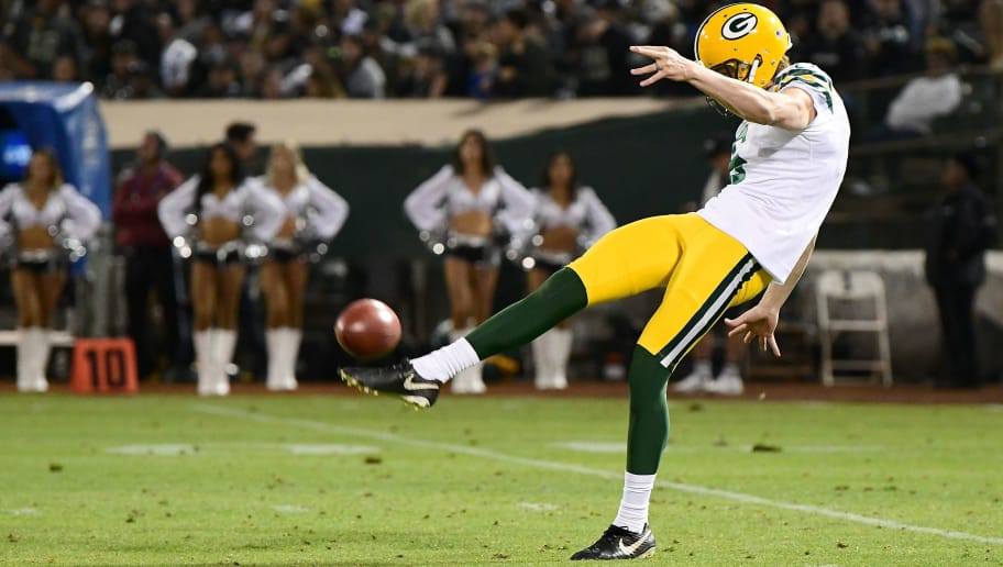 OAKLAND, CA - AUGUST 24:  JK Scott #6 of the Green Bay Packers punts the ball against the Oakland Raiders during the second quarter of an NFL preseason football game at Oakland-Alameda County Coliseum on August 24, 2018 in Oakland, California.  (Photo by Thearon W. Henderson/Getty Images)