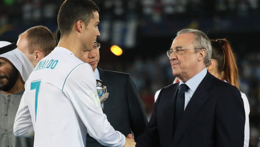 ABU DHABI, UNITED ARAB EMIRATES - DECEMBER 16:  Cristiano Ronaldo of Real Madrid shakes hands with Real Madrid President Florentino Perez at the end of the FIFA Club World Cup UAE 2017 final match between Gremio and Real Madrid CF at Zayed Sports City Stadium on December 16, 2017 in Abu Dhabi, United Arab Emirates. (Photo by Matthew Ashton - AMA/Getty Images)