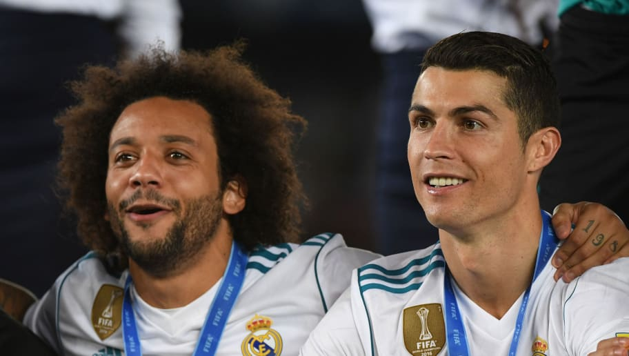 ABU DHABI, UNITED ARAB EMIRATES - DECEMBER 16:  Cristiano Ronaldo and Marcelo of Real Madrid CF celebrates the win of the Club World Cup on December 16, 2017 in Abu Dhabi, United Arab Emirates.  (Photo by Kaz Photography/Getty Images)
