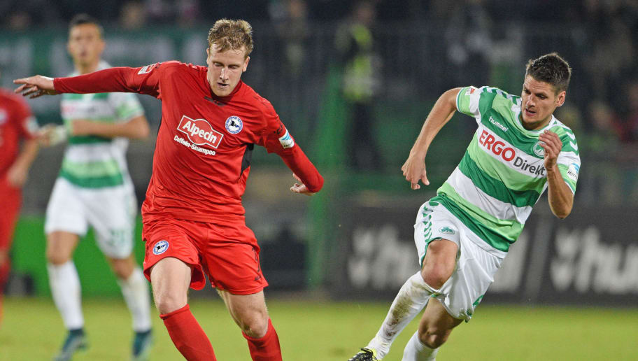 FUERTH, GERMANY - NOVEMBER 06: Andreas Hofmann (R) of Fuerth and Brian Behrendt of Bielefeld fight for the ball during the Second Bundesliga match between Greuther Fuerth and Arminia Bielefeld at Stadion am Laubenweg on November 6, 2015 in Fuerth, Germany. (Photo by Thomas Starke/Bongarts/Getty Images)