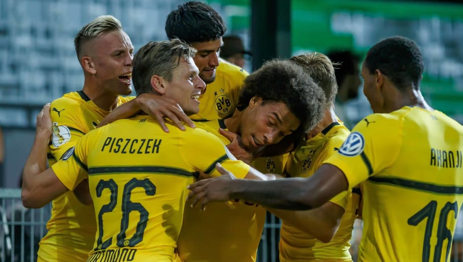 FUERTH, GERMANY - AUGUST 20: Axel Witsel of Borussia Dortmund celebrates after scoring his team`s first goal with team mates during the DFB Cup first round match between Greuther Fuerth and Borussia Dortmund at Sportpark Ronhof Thomas Sommer on August 20, 2018 in Fuerth, Germany. (Photo by TF-Images/Getty Images)