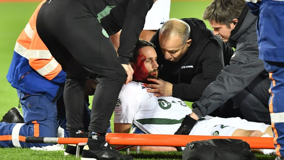 Saint-Etienne's Serbian defender Neven Subotic (C) receives medication after being injured  during the French L1 football match between FC Girondins de Bordeaux and AS Saint-Etienne at the Matmut Atlantique stadium in Bordeaux, southwestern France on December 5, 2018. (Photo by NICOLAS TUCAT / AFP)        (Photo credit should read NICOLAS TUCAT/AFP/Getty Images)