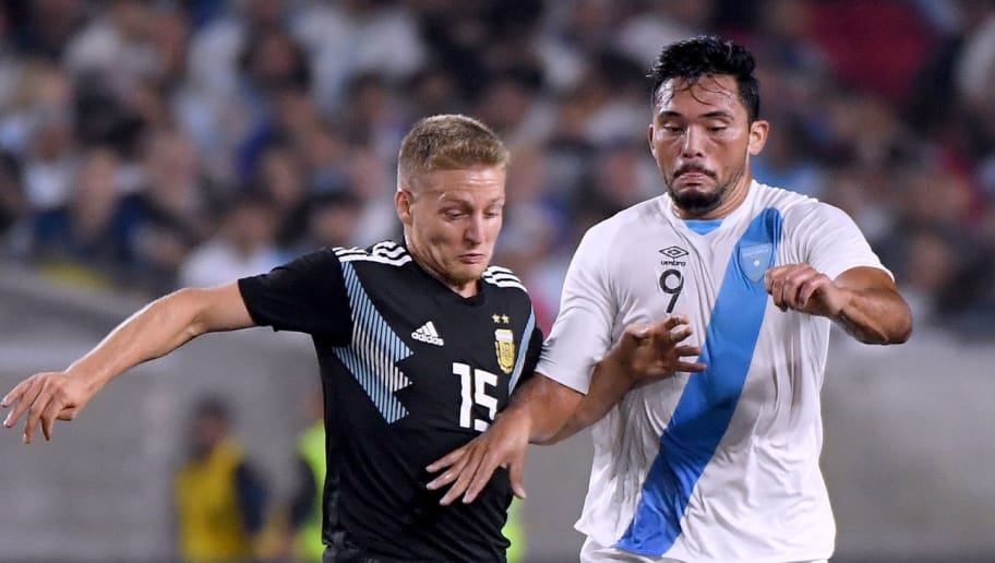 LOS ANGELES, CA - SEPTEMBER 07:  Wilber Perez #9 of Guatemala is surrounded by Argentina lead by Santiago Ascacibar #15 during the second half in a 3-0 Argentina win at Los Angeles Memorial Coliseum on September 7, 2018 in Los Angeles, California.  (Photo by Harry How/Getty Images)